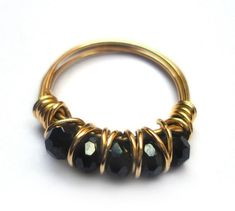 Items similar to Gold wire wrapped ring, black beads, wire wrap ring, cocktail ring on Etsy Pearl Jewelry, Wire Jewelry, Jewelry Crafts, Jewelry Rings, Unique Jewelry, Diy Schmuck, Schmuck Design, Handmade Rings, Handmade Necklaces
