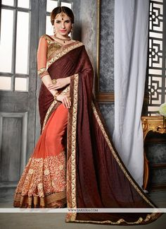 Be the sunshine of everybody's eyes dressed in such a gorgeous brown crepe jacquard and net designer saree. Beautified with embroidered and patch border work all synchronized well with the pattern a...