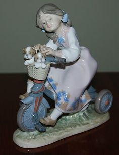 LLadro Figurine - Little Girl riding bicycle with two puppies in basket