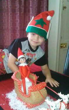 "My grandson Randy II...First day experiencing the ""Magic"" of his elf, Lil Red <3 2013"