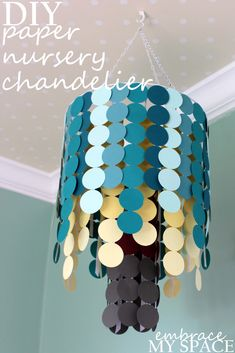 DIY Nursery Mobile - using cardstock, ribbon and a hanging planter! #DIY #nursery #mobile - could be a good light fixture cover