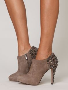 I LOVE these! I have simple ankle booties...wonder if I could add my own spikies....
