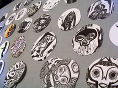 details from linocuts being made into magnets and coaster sets