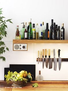 I like the simple qualities of this, natural wood, all different oil/vinegar bottles, black, white, fruit, plants...