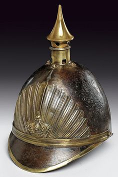 A helmet, Europe, 19th century. Looks very steampunk as the top spike looks like a steam whistle