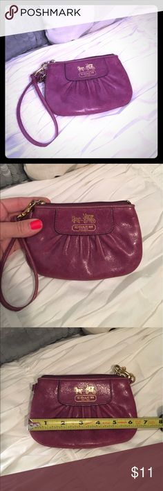 Authentic coach wristlet Authentic coach purple leather wristlet. Used. Gorgeous color and supersoft! Small ink mark on the very back. Coach Bags Clutches & Wristlets