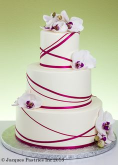 Contemporary Garland Cake. Not with orchids but maybe paua....and a dif color ribbon