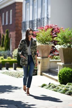 Camo jacket + stripe top + jeans + gold or nude pumps