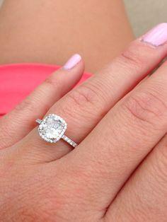 Cushion cut, halo diamonds, thin diamond band | bridesandrings.com