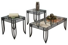 """The sleek design of the """"Exeter"""" accent table collection will deliver a sharp sense of style to any room in your home. The sharp corners and gentle curves of the tubular metal frame supporting a clear glass inset give this collection the look of an artistic sculpture. The welded tubular stacked apron frame has a textured finish which makes it pleasing to the touch as well as a feast for the eyes. Enhance your living room's beauty with the rich contemporary design of the """"Exeter"""" accent table…"""