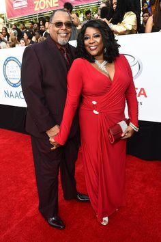 """The NAACP Image Awards-""""Grey's Anatomy"""" actress Loretta Devine matches the carpet at the NAACP Image Awards, alongside Glenn Marshall. Loretta Devine, Black King And Queen, Aging Gracefully, Celebs, Celebrities, Beautiful Black Women, Red Carpet, Queens, Awards"""