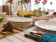 This cozy rustic look works well for early autumn dinner parties or casual settings all year round.  A burlap runner adds a natural organic flair to the setting.  Photo by Lawrence Luk.