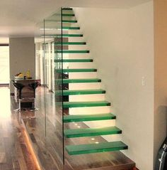 Glass Stairs. Beautiful. Impractical. I have these in my Imaginary Home.