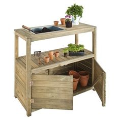 An extremely handsome, sturdily constructed potting table, complete with galvanized steel tray, centre shelf and good sized cupboard space. A must for all those messy jobs in the greenhouse or garden room, yet strong enough to leave outside throughout the Outdoor Potting Bench, Potting Tables, Black Baccara, Armoire En Pin, 233, Wood Source, Good Housekeeping, Plantation, House And Home Magazine