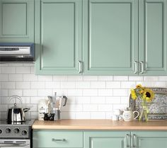 mint kitchen + white subway tile just needs a dark grey granite and its set. Love this color!!