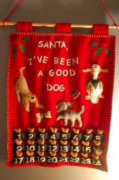 This was my mother's early Christmas present for her grandpuppy, Darwin. She purchased the calendar, but the dog biscuits are HOMEMADE!!!  Darwin received his first biscuit last evening when I got home from work. When I left this morning, he was sitting beneath it, nose turned up, whining for another!  It is hard to explain the concept of 'advent' to a creature whose brain is located in his belly…