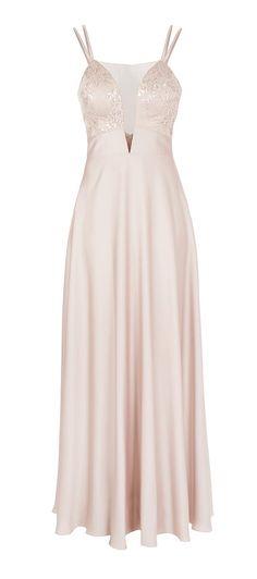 Com saia rodada e excelente caimento, o Vestido segal com decote profundo Ayla é um modelo de vestido longo de segal e tule com paetê. A base é uma saia rodada lisa com um lindo caimento combinando co...