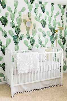 Cactus wallpaper behind the crib in this very adorable and quite unique nursery! http://ajdunlap.com/interior-architectural-photography-stephanie-tidwell-interiors/