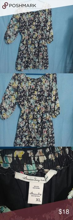 A lovely peasant style floral dress This dress is absolutely beautiful. Very flattering size XL American Rag from Macy's is the brand the sleeve stop at the elbow it gathers at the waist it is lined. Wash Coldwater casual and hang dry my daughter wore this dress to the Demi Lovato concert she got a lot of compliments. In the winter wear with leggings in the spring and summer wear with adorable sandals. The colors are black cream yellow turquoise blue a little bit of red the flowers in it are…