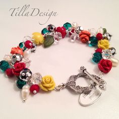 Colorful bracelet with carved coral roses, crystal and freshwater pearls from TillaDesign.