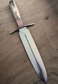 Hand Forged Dagger (Arkansas Toothpick) The handle was taken from trimmed peices of red deer antler with a copper balster and hand forged steel hilt. The blade itself was re-forged from a scrapped high carbon steel engineer file.