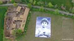 "Gizmodo: Giant Portrait Shows Drone Operators That People Aren't ""Bug Splats"" / The giant portrait was installed by an artist collective in the region of Khyber Pukhtoonkhwa in Pakistan, an area were drone attacks occur on a fairly regular basis. The identity of the child depicted in the portrait is currently unknown, but according to the Reprieve/Foundation for Fundamental Rights, she has lost both of her parents as well as two siblings to drone attacks."