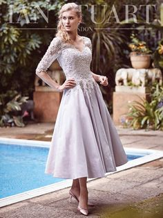 A stunning Mother of the Bride & Mother of the Groom dress from the Beverly Hills Spring/Summer 2015 Collection by Ian Stuart London. This dress has been beautifully designed in a dolce taffeta & metallic beaded Lace fabric in a light purple/parma violet Mother Of The Bride Gown, Mother Of Groom Dresses, Mothers Dresses, Mob Dresses, Tea Length Dresses, Bridesmaid Dresses, Bride Dresses, Party Dresses, Red Carpet Dresses