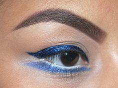 Blue, winged eyeliner.