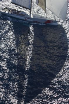 Sailboat in the reflection of the sea. Maybe the Bahamas, Caribbean, Aegean, or other deep blue ocean. ... #sailing