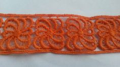 Check out this item in my Etsy shop 5.5 https://www.etsy.com/listing/217865047/2-yards-orange-organza-lace-trim-flower