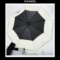 """CHANEL Umbrella W/ Quilt Purse & Box NEW VIP This Chanel umbrella was a promotional item for VIP clients and was not retailed in Chanel Boutiques Measurements.-NOT SOLD in STORE. The diameter measures 38"""" 1/2 inches from point to point The handle measures 20"""" inches in length when the umbrella is open. New with Tag. comes with black quilted Cylinder purse with long chain & comes with the Chanel cardboard presentation storage box. Brand NEW. Chanel  Accessories Umbrellas"""