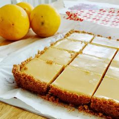 CREAMY LEMON SQUARES, FOR THE CRUST 4 tablespoons butter, melted and cooled, plus more for pan cup graham cracker crumbs cup sugar FOR THE FILLING 2 large egg yolks 1 can ounces) sweetened condensed milk cup fresh lemon juice lemons) How Lemon Desserts, Köstliche Desserts, Dessert Recipes, Pudding Recipes, Chocolate Chip Cookies, Chocolate Squares, Dessert Bars, Rocky Road, Food Processor Recipes