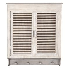 This elegant Louvered wall cabinet is an attractive way to add storage to your bathroom or other small area without taking up valuable floor space. A whitewashed finish accents a French door style opening perfectly.