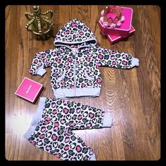 Juicy couture infant tracksuit Brand new never worn no tags 100% authentic. Adorable infant cheetah print juicy couture tracksuit Juicy Couture Other