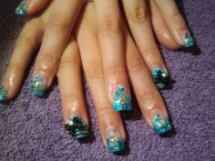 blue zebra glitter nails  call Kristal at 916-670-0010 for an appointment in Sacramento