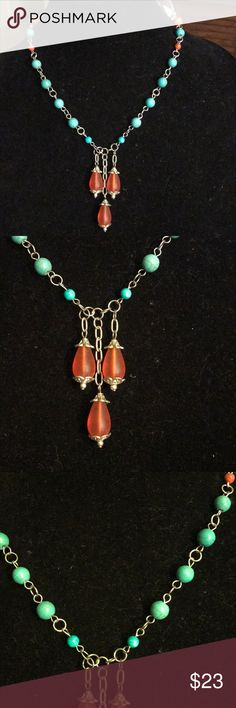 "Howlite recycled glass necklace handcrafted Necklace is made with blue howlite rounds, orange howlite rounds and orange recycled glass with a lobster clasp  Necklace measures 18""  I designed and crafted this in my home studio  Necklace is one of a kind. I believe each piece of jewelry be as unique as the woman wearing it  All gemstones are authentic and designer grade  Necklace will arrive in an organza pouch ready to be given as a gift or as a gift for yourself   Check out my closet for…"