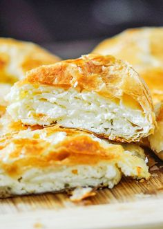 Savory Cheese Pie (Placinta Cu Branza) - Ricotta cheese, feta cheese and seasonings wrapped in puff pastry and baked until golden. Cheese Pie Recipe, Cheese Pies, Greek Cheese Pie, Cheese Pastry, Cheese Bread, Pastry Cake, Goat Cheese, Milk Recipes, Greek Recipes