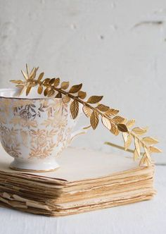 Gold leaf Grecian headband. Gold has been around for many a millennia, and this harkens back to one of the most beloved early usages!