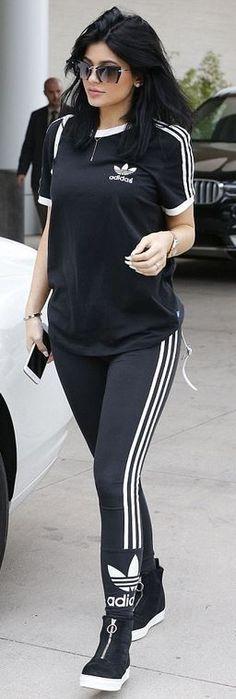 Kylie Jenner: Bracelet – Cartier  Watch – Rolex  Shirt and pants – Adidas Originals  Sunglasses – Miu Miu