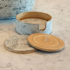 This coaster set comes with four bamboo and lacquer coasters with a holder where they can be stacked and put aside. Each of the four coasters has a cork p...