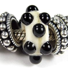 Ivory Large Hole Bead With Raised Black Dots lhb276064rd, Handmade Lampwork Glass Bead, Slider Bracelet Bead (Choices of Shiny or Etched)) This beautiful organic ivory glass bead was handmade using ivory glass. I added some beautiful raised black dots. Price is for one bead only. Bracelets, sterling silver charms, other glass charm beads, and anything else beads not included in the listing. Other photos are for visual examples only. Sold individually by the bead.