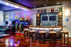 An awesome man cave with all the right touches, including a bar, video games and TVs! Click to see how to turn your garage into the man cave of your dreams.
