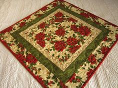 #PatchworkMountainArtfire on Artfire                #table                    #Quilted #Table #Topper #Poinsettias, #Centerpiece, #Christmas #Topper        Quilted Table Topper Poinsettias, Centerpiece, Christmas Topper                                         http://www.seapai.com/product.aspx?PID=1548820