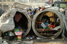 While many areas of Asia are fast developing, many desperate citizens in Manila in the Philippines are forced to find shelter in in whatever makeshift homes they can find in the slums. Manila Philippines, Philippines Travel, Dalai Lama, Que Horror, Powerful Pictures, Holy Week, Slums, African History, People Around The World