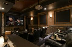 Home theatre room love the set up, I would have a big sofa in the back though