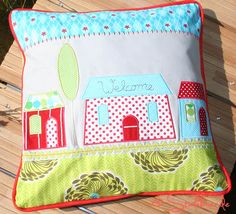 Pillow with machine embroidered applications