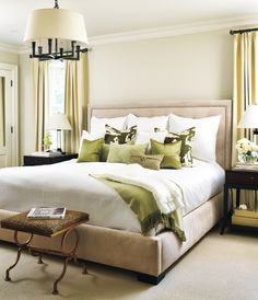 Love the bed and the neutral palette, with the green accents. Also like the black chandelier with the drum shade. No fussiness.