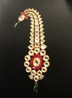 A fabulous jigha, or turban ornament. This is worn on the front of the turban, and has an enameled reverse side along with a mechanism to insert a heron feather within it. It is from the 18th century, North India.