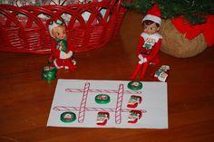 Elf on the Shelf idea tic-tac-toe with chocolate Santas