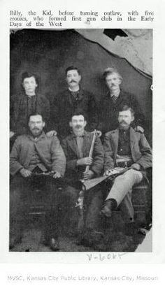 Postcard which says: Billy, the Kid, before turning outlaw, with five cronies, who formed first gun club in the Early Days of the West. Postcard from Boot Hill Gift & Curio Shop, Dodge City, Kansas.